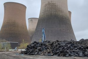 Waste plastic in front of a cooling tower