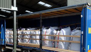 Lorry loaded with bags of uPVC regrind